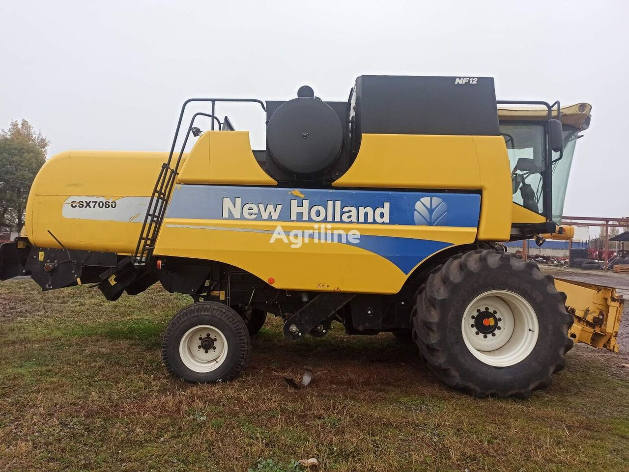 зерноуборочный комбайн NEW HOLLAND CSX 7080 с жаткой 7,6 и тележкой